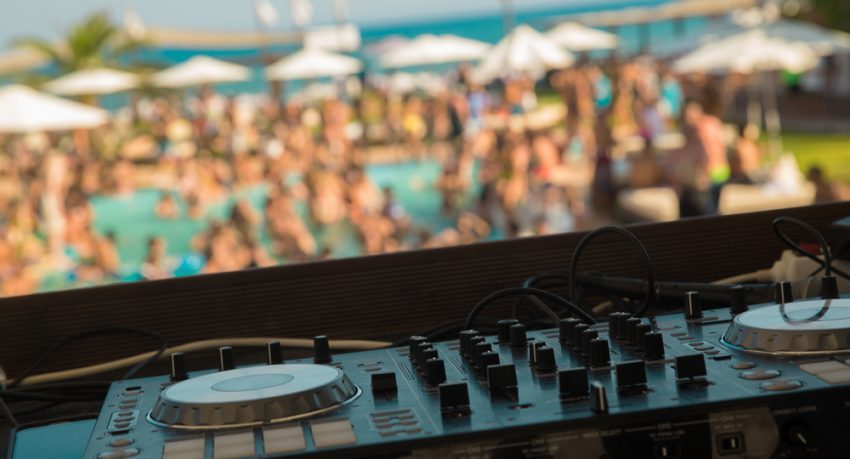 DJ Mixing at pool party