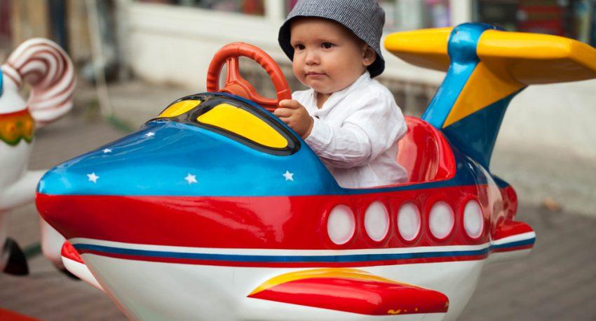 child riding a ride at orlando theme park