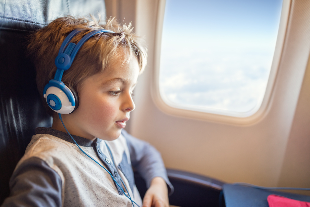 child getting entertained on a plane