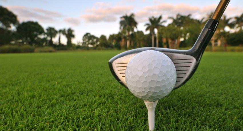 golf ball on tee on florida golf course at dawn