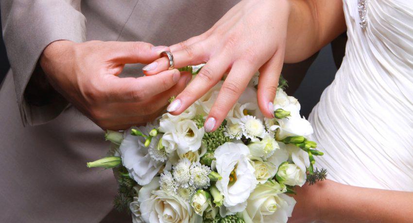 man putting womans ring on finger in las vegas
