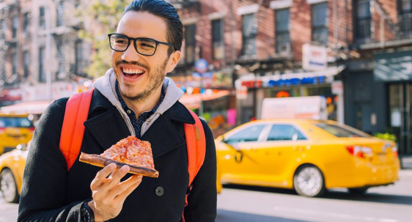 new yorker eating pizza