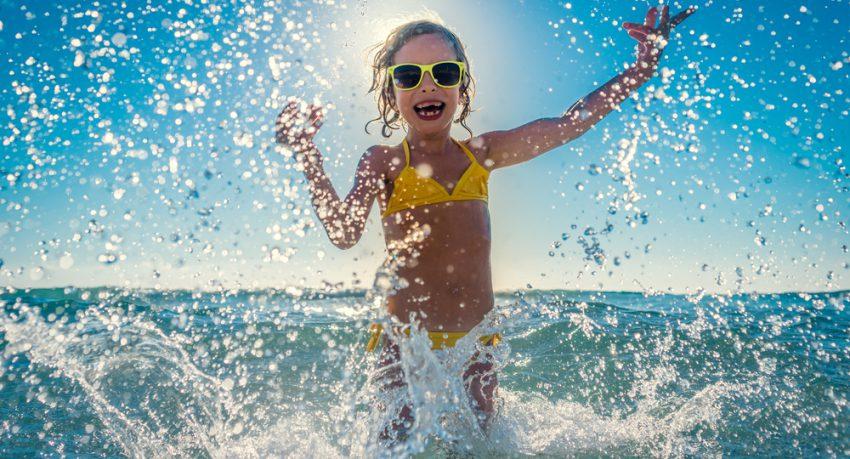 child enjoying the sea