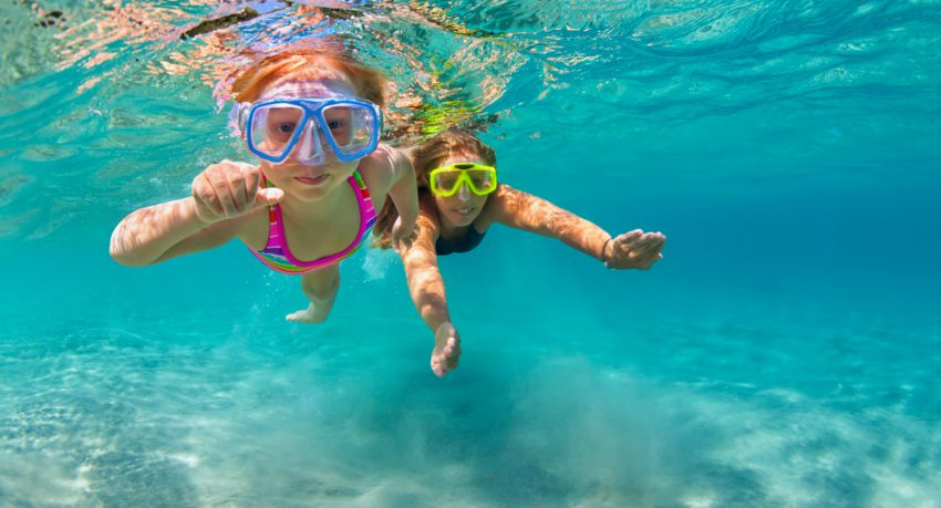 children snorkelling during school holidays