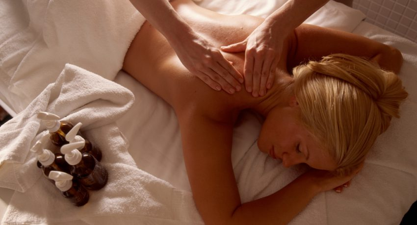 lady getting back massage at spa